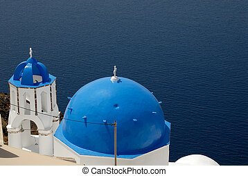 Greek church with blue cupola in Santorini, Greece