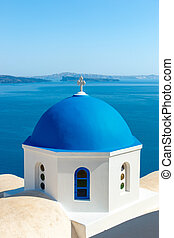 Greek church with blue dome in Oia, Santorini