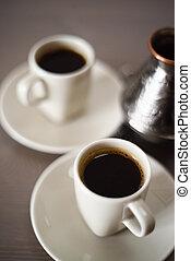 Greek coffee prepared in copper cezve coffee pot minimalist style