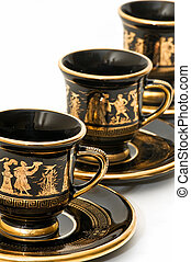 Greek art cups on white background