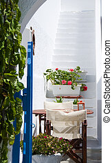 greek cyclades island architecture with flowers