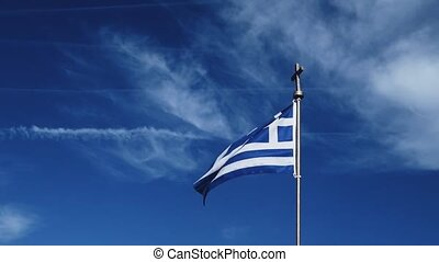 Greek flag and blue sky on a windy day, travel and politics ...
