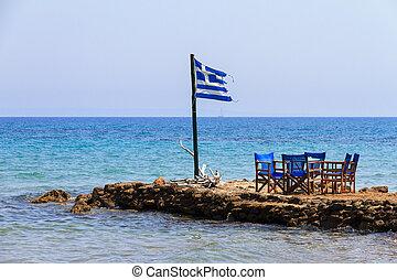 Greek flag at the sea