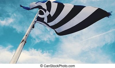 Greek flag flutters in the wind
