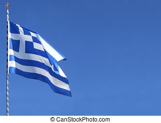 Greek Flag - Greek flag flying against bright blue sky