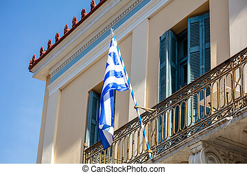 Greek flag on a balcony of a neoclassical house, Ahens,...