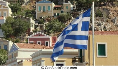 Greek flag on the background of houses
