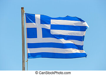 Greek flag on the blue sky background