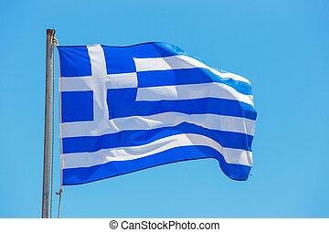 Greek flag on the blue sky background