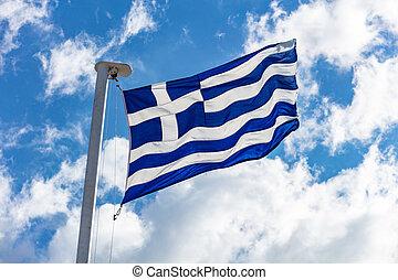 Greek flag waving on blue sky background