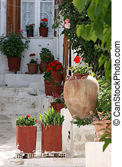greek house in spring - traditional white old style greek...