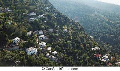 Greek houses on the hillside, aerial view - Greek houses on...