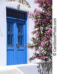 greek island ancient building door with flowers
