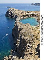 Greek Island Coastline - A blue lagoon near the town of...