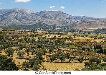 greek landscape with meadow, mountain and blue sky, demeter temple in background.