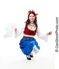 Greek national dance - Woman squat dancing with kerchief in...