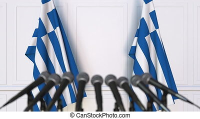 Greek official press conference. Flags of Greece and...