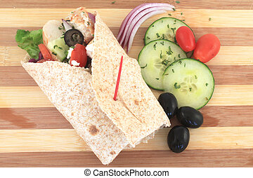 Greek salad chicken wrap - Healthy chicken wrap greek style...
