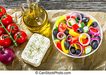 Greek salad in a white bowl, view from above