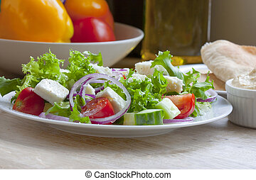 greek salad shot in natural daylight in kitchen