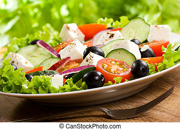 greek salad - salad with vegetables and greens