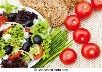 salad with tomatoes chives and bread - greek salad with ...