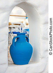 Greek style ceramic blue vase on white wall background