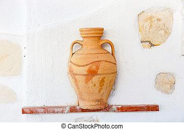 Greek style ceramic  vase on white wall background