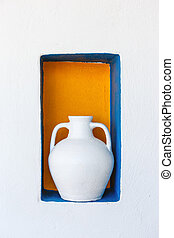 Greek style ceramic white vase on white wall background