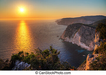 Greek Sunset - Beautiful sunset at the cliffs of Keri on the...