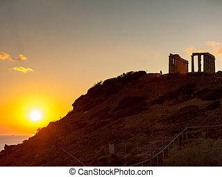 Greek temple of Poseidon at sunset, Cape Sounio - Greece...