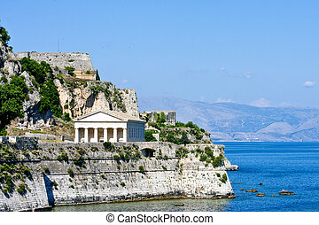 An ancient greek temple and church on the coast of Corfu Greece