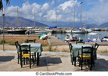 Greek terrace in harbor