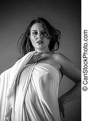 Greek woman, ancient goddess with white cloth in the wind