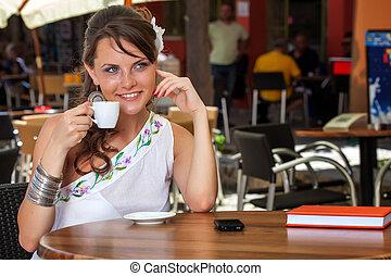 Greek woman in cafe