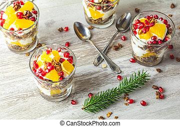 Greek yogurt with granola and orange for healthy breakfast