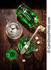 Green Absinthe Sugar Cube - Green absinthe liquor in glass ...