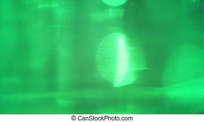 Green abstract light shapes shining randomly in space....