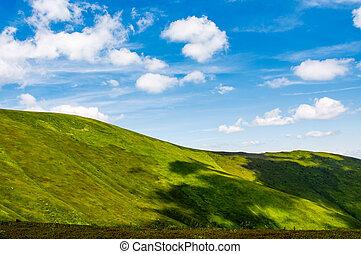 green alps under blue sky. gorgeous mountainous landscape...