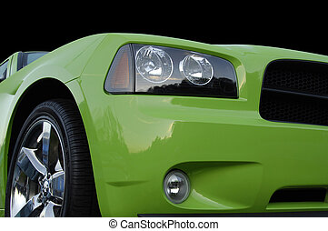 Green American Muscle Car isolated against black background