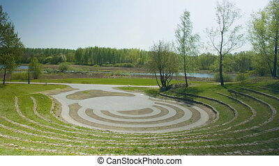Green amphitheatre int the garden, summer daylight.