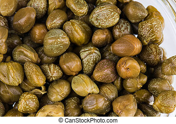 Green and appetizing capers. To be used as background.