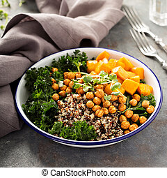 Green and healthy grain bowl with roasted chickpeas - Green...