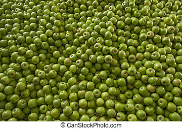 Green and juicy granny smith apple pile at the local farmers...