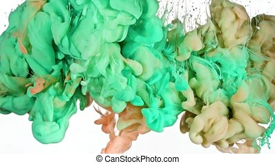 Green and Orange Ink in Water - Green and Orange inks are...