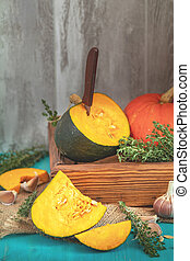 Green and orange Pumpkin and ingredients for tasty vegetarian cooking