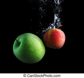 Green and red apples in water