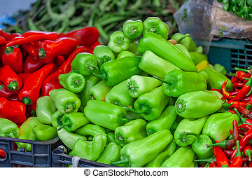 Green and Red fresh peppers from market.