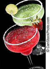 Green and Red Margarita in front of a black background with...