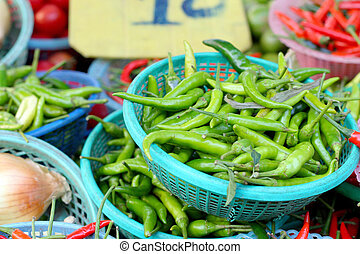 green and red pepper in the market